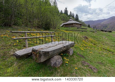 Bench and bunker Ukrainian partisans mountains in the background. Carpathians