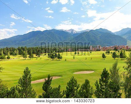 A view of the peaks of Pirin Mountain (Vihren and Todorka) Golf Club Razlog Bulgaria