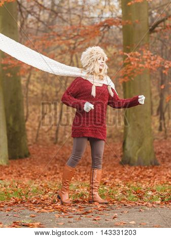 Fashion Woman In Windy Fall Autumn Park Forest.