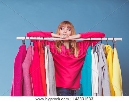 Woman Choosing Clothes In Mall Or Wardrobe