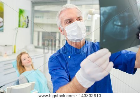 Dentist holding up an x-ray