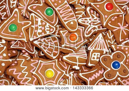 Lot of gingerbread cookies with colorful lentils