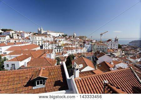 Cityscape from the lookout on top of the Alfama (Miradouro das Portas do Sol) towards the Monastery of Sao Vicente de Fora in Lisbon Portugal.