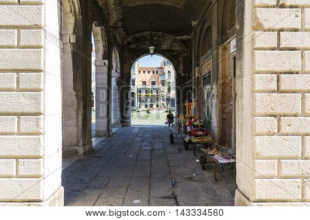 VENICE,ITALY-AUGUST 17,2014:view of the man looking the Grand canal by the arcade near the Rialto bridge during a sunny day.
