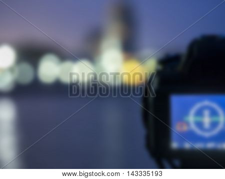 Blurry close up camera the night view of city, background Landscape out of focus
