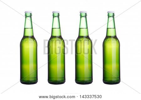Four Green Beer Bottles On The White Background