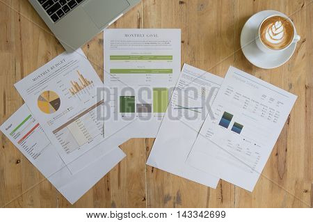 Business graphs and charts with laptop computer. top view