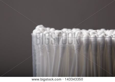 Cotton Buds With Plastic Packing On A Dark Background