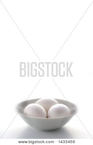 Three White Eggs In A White Bowl