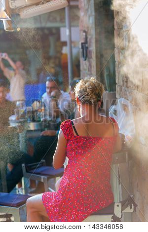 People Sitting At A Street Cafe In Florence