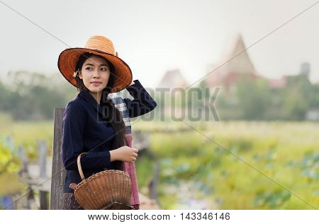 Beautiful Thai local woman working in Thailand countryside