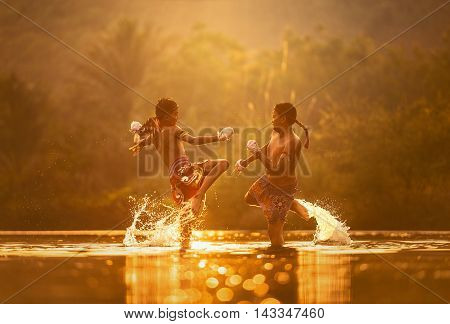 Thai kickboxing. Muay thai sports boys fighting