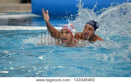 Budapest, Hungary - Jul 17, 2014. KLIKOVAC Filip (MNE, 11) against BUSILA Dan Andrei (ROU, 6). The Waterpolo European Championship was held in Alfred Hajos Swimming Centre in 2014.