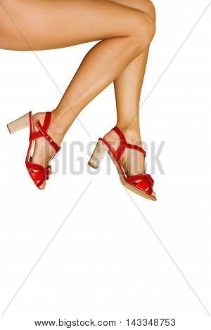 Woman legs with red high heels shoes isolated on white background.