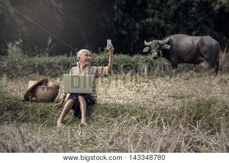 Asian woman take selfie with cellphone outdoor