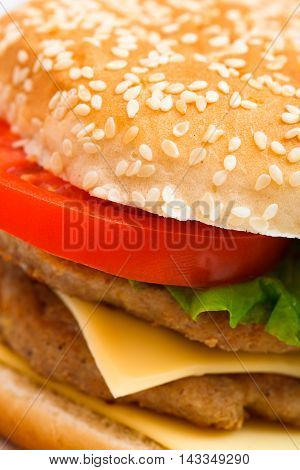 Big Hamburger With Sesame Seeds, Fresh Vegetables And Juicy Meat