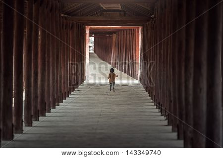 Small child walking alone in walking path