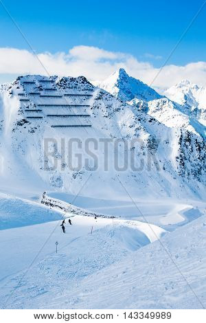 Avalanche snow bridges and ski slope in mountain ski resort Kals-Matrei, Austria - winter sports and beautiful nature.