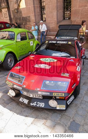 Nurnberg Bavaria / Germany - July 19th 2014: red Alpine A 310 sport vintage car at Sud - Rallye- Historic event in Nurnberg