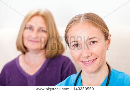 Photo of middle aged woman with the young doctor