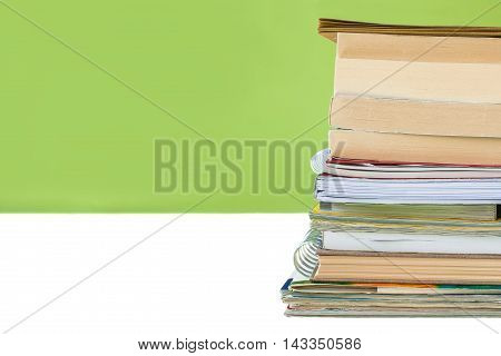 Back to school concept - Student's desk with a pile of notebooks. Close up image.