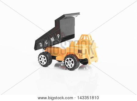 Yellow toy dump truck industrial isolated on white background
