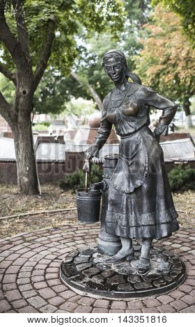 Rostov-on-Don Russia -August 14 2016: Monument to the water supply - woman collects water in a water column. Sculptors: A.Dementev S.Oleshnya