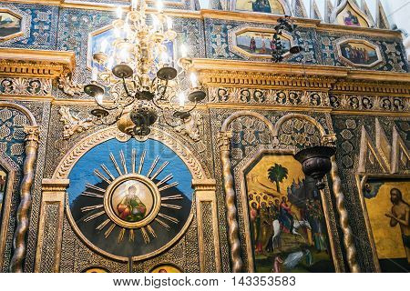 Moscow, Russia - August 7, 2016: iconostasis and paintings on the walls of St. Basil's Cathedral in Moscow. Russia. Focus on a golden sun on the left side