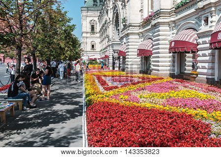 Moscow, Russia - August 7, 2016: Tourists and shoppers walking around GUM in Moscow. GUM large shopping mall in the city center, which occupies an entire city block