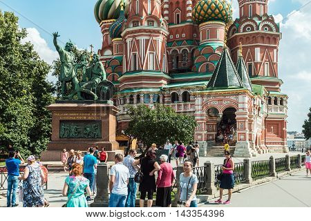 Moscow, Russia - August 7, 2016: Tourists and townspeople in Red Square near the Pokrovsky Cathedral St. Basil's Cathedral in Moscow