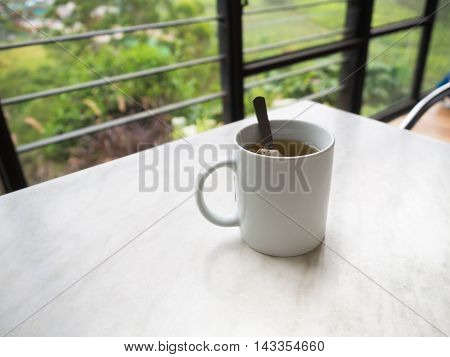 White Tea Cup On The Table At Boh Tea Plantation
