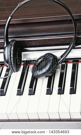 Headphones are on the black and white piano keys