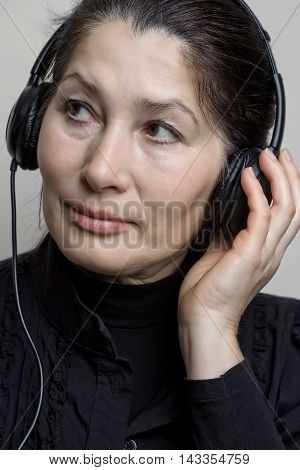 Beautiful mature asian woman  listening to music through