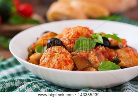 Juicy meatballs of turkey meat with vegetables (zucchini eggplant olive tomato)
