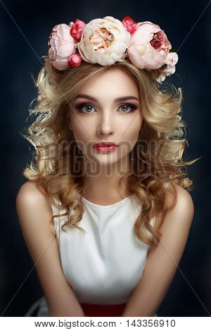 Romantic gerl in Wreath of Flowers with Perfect Skin