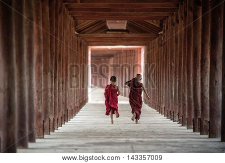 Back side of Buddhist novice are walking in pagodamyanmar