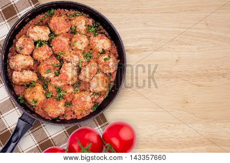 Homemade meatballs in tomato sauce. Top view.