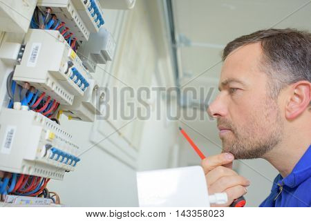 Man stood by a fusebox