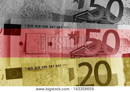 Euro banknotes, switch and German flag - Finance concept