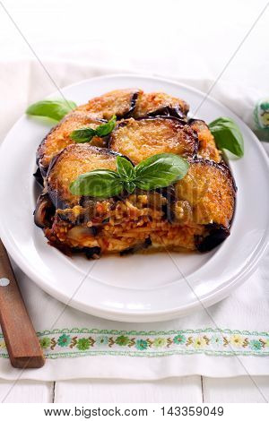 Aubergine timbale - pasta with tomato sauce and mozzarella covered with aubergine