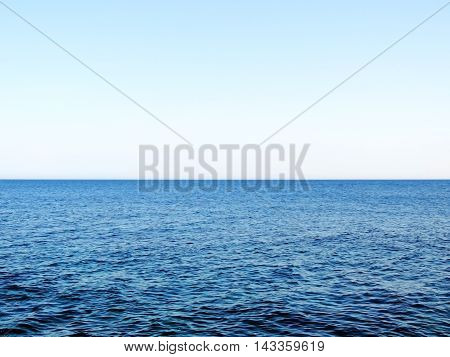 Sea sea with open water and wavy texture with bus sky and copy space. Horizon over water.