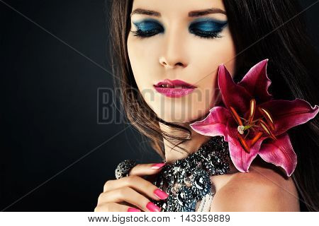 Woman with Makeup and Flower. Blue Eye Shadow Make-up Pink Lips