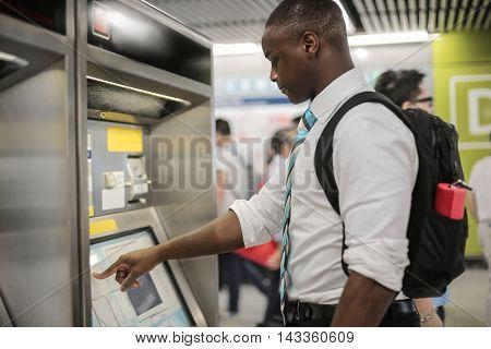 Man buying a metro ticket