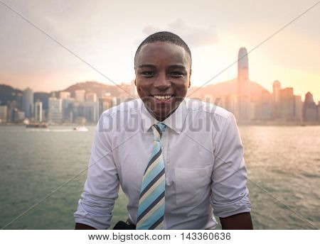 Smiling young businessman posing for a picture