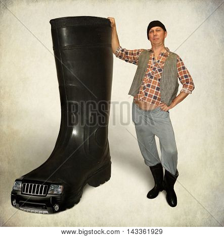 A man advertises good rubber boots for sale.