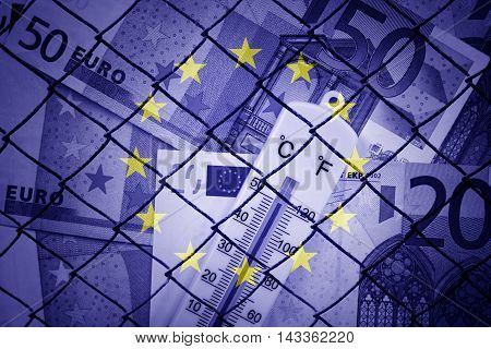 Fence, euros and EU flag - Finance/Business concept