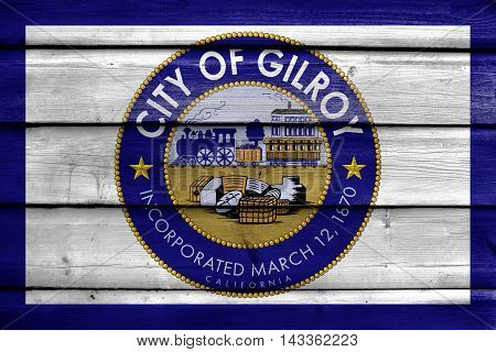 Flag Of Gilroy, California, Usa, Painted On Old Wood Plank Background
