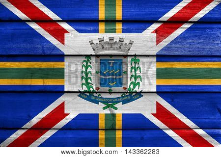 Flag Of Governador Valadares, Minas Gerais State, Brazil, Painted On Old Wood Plank Background