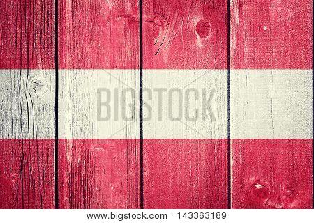 Vintage Austrian flag on wood background - flag concept