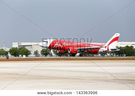 BangkokThailand-January 112014: HS-ABF Thai Air asia Airbus a320-216 touching down on runway at Don Mueang International Airport.Thai Air Asia company is one of low cost airlines in Asia